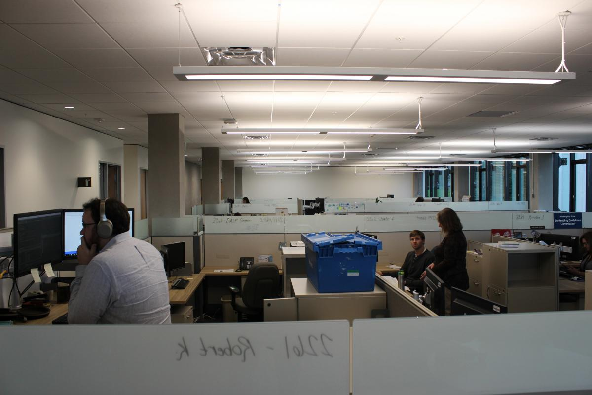 Workers with the Office of Financial Management in new office space
